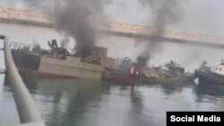 Konarak naval vessel still burning after being towed to port. May 11, 2020.
