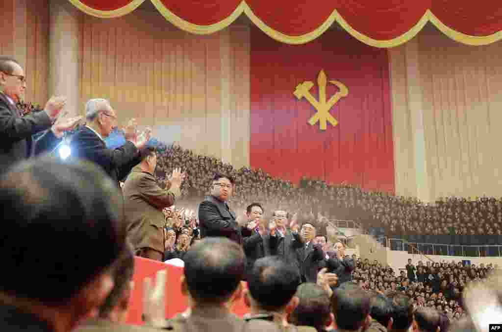 This photo taken on December 28 by North Korea's official Korean Central News Agency shows leader Kim Jong Un (center) at a concert in Pyongyang. (AFP/KCNA)