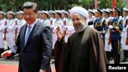 آقایان روحانی و شی، در دیداری که سال گذشته در شانگهای داشتند