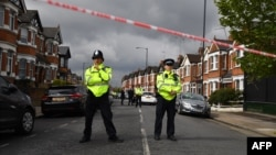 British police officers secure a cordon in a residential street in northwest London on April 28.