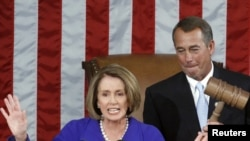 U.S. -- Outgoing House Speaker Nancy Pelosi yields the podium to incoming House Speaker John Boehner as he wields the speaker's gavel for the first time after being elected Speaker, Washington, DC, 05Jan2011