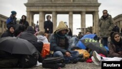 FILE: Afghan refugees protest in front of Brandenburg Gate in Berlin in 2012.