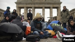 FILE: Afghan refugees protest in front of the Brandenburg Gate in Berlin.