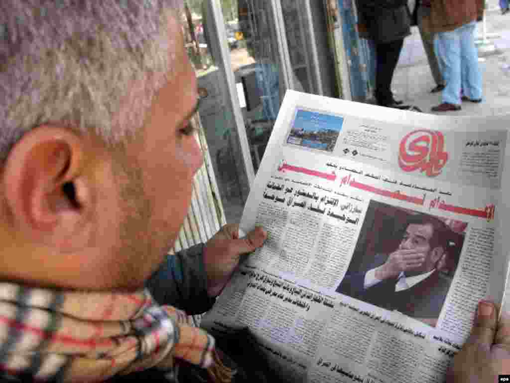 "An Iraqi man reads the news on Saddam's trial and sentencing in Baghdad, after a court rejected his appeal, December 27, 2006. ""God willing, Saddam will be hanged as soon as possible,"" one Baghdad man told Radio Free Iraq. The former Iraqi dictator was hanged three days later."