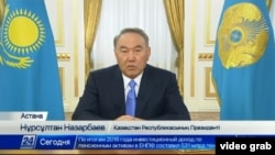 Kazakh President Nursultan Nazarbaev addresses the nation live on TV on January 30. It was his second such speech in just under a week.