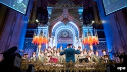 The choir of the Alexandrov Ensemble of the Russian Army performs during a ceremony commemorating the 70th anniversary of the liberation of the Budapest Jewish ghetto in the Dohany Street Synagogue in Budapest on January 18.