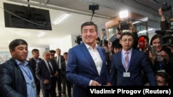 Presidential candidate Sooronbai Jeenbekov casts his ballot at a polling station during the presidential election in Bishkek on October 15. REUTERS/Vladimir Pirogov