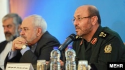 Former defense minister and current advisor to Khamenei, Hossein Dehghan and foreign minister Mohammad Javad Zarif in a press conference in Tehran, undated.