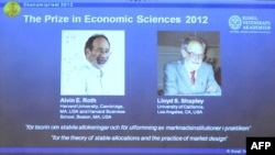 Sweden -- A screen displays photos of the winners of the Nobel prize in Economic Sciences US Alvin Roth (L) and Lloyd Shapley during the press conference of the Royal Swedish Academy of Sciences, Stockholm, 15Oct2012