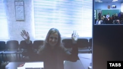Jailed Pussy Riot punk rock group member Maria Alyokhina appears on a monitor during a video conference from the penal colony for a parole hearing on May 22, when she announced the launch of her hunger strike.