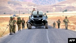 Turkish troops patrol in Sirnak Province, near the Iraqi border, on June 21.