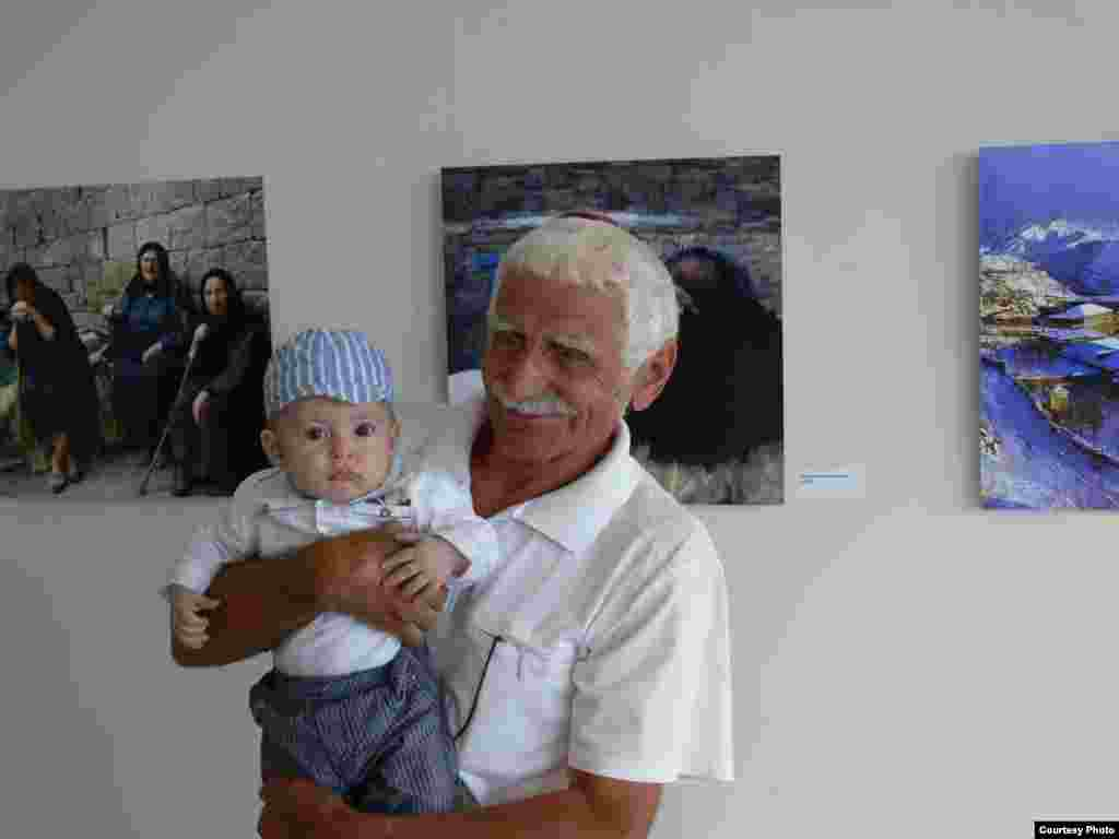 Photographer Kamil Chutuev at the exhibition of his and others' images in Makhachkala on August 29, 2013