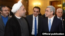 Iran - Newly elected President Hassan Rohani (L) meets with his visiting Armenian counterpart Serzh Sarkisian in Tehran, 5Aug2013.