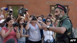 Armenia -- An armed man speaks to the press after pro-opposition gunmen locked in a week-long hostage standoff with Armenian authorities released the final four police officers held captive in Yerevan, July 23, 2016
