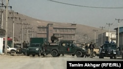 Afghan security forces surrounded the site of a suicide bombing attack in Kabul on March 17.