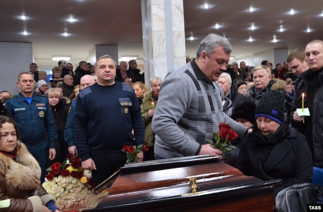 People attend a funeral for victims of the explosion in Vorkuta on February 29.