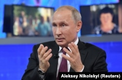 Russian President Vladimir Putin speaks during the marathon call-in show.
