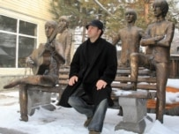 Sculptor Eduard Kazaryan poses next to his tribute to the Beatles in Almaty, Kazakhstan (TASS file photo)