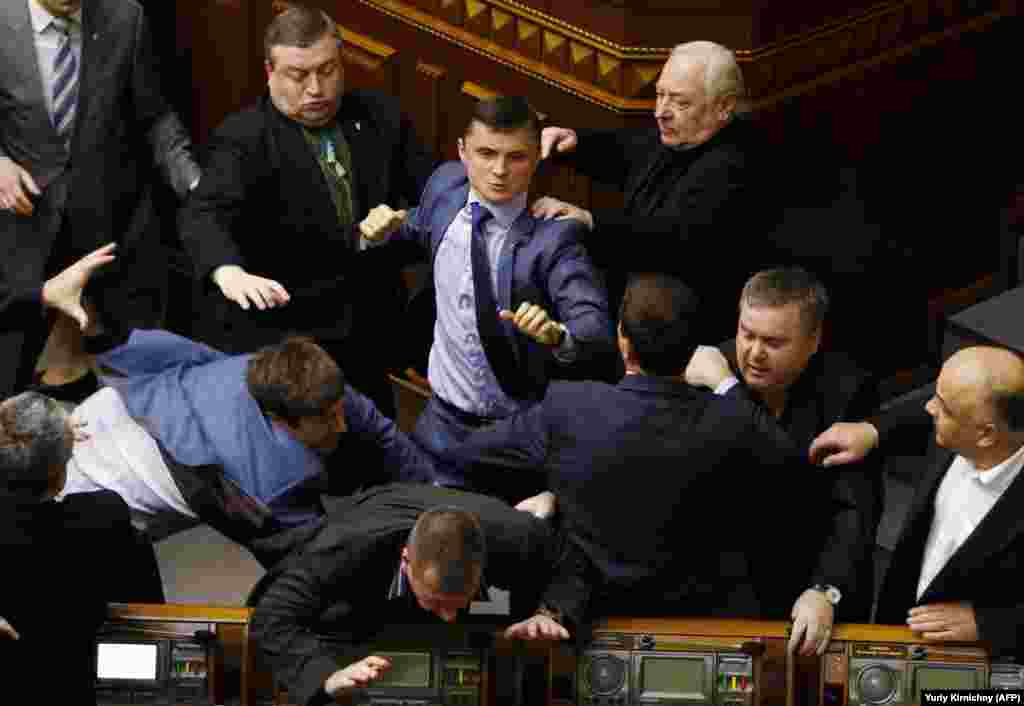 A right hook from the far-right as Mykhaylo Holovko from the Svoboda party clashes with members of the Communist Party in April 2014.