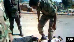 A YouTube video grab allegedly shows Syrian security forces beating up handcuffed and blindfolded detained men near the central city of Homs