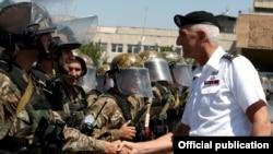 Armenia - The commander of the U.S. Army in Europe, Lieutenant General Mark Hertling, inspects Armenian peacekeeping troops in Yerevan, 18Jul2012.