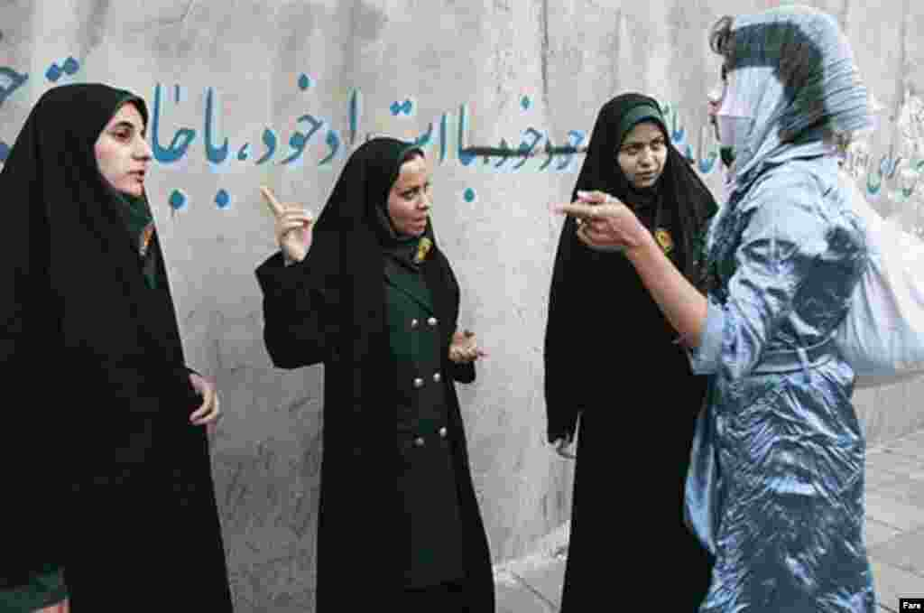 Police and Basij activists check women for proper dress in Tehran on April 22 (Fars) - Ahmadi-Moqaddam said 13 detained women have been handed over to judiciary officials. He told reporters the police campaign is not just aimed at making women wear their scarves conservatively, but at enhancing public security for women and their families.