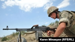 Nagorno-Karabakh -- An Armenian soldier on frontline duty in northeastern Karabakh, 20Jul2012
