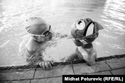 Ismail chats with a friend in the pool