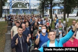 Workers from the BelAZ automobile plant march in Zhodzina on August 26. One of the most notable aspects of the postelection protests against Lukashenka is that many factory workers, long considered the bedrock of his base, have also participated
