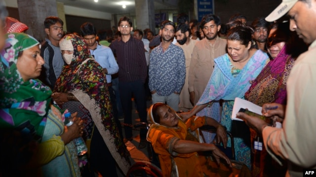 Relatives of injured victims gather outside the hospital in Lahore, Pakistan, after a deadly blast hit a public park on Easter Sunday, killing dozens and wounding hundreds more.