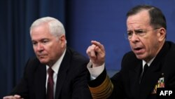 U.S. Defense Secretary Robert Gates and Chairman of the Joint Chiefs of Staff, Admiral Mike Mullen, acknowledged Washington is considering possible military action in the Libyan crisis.