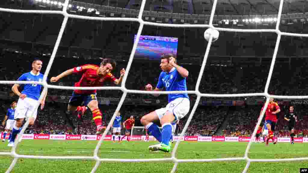 David Silva heads the ball to score Spain's first goal in a 4-0 victory over Italy in the Euro 2012 final at the Olympic Stadium in Kyiv on July 1. In winning Euro 2012, Spain became the first nation to win three major international tournaments in succession. (AFP/Giuseppe Cacace)