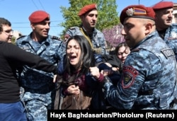 A demonstrator is detained by police in Yerevan on April 16.
