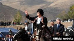 Otunbaeva visits the Kyrgyz region of Osh in October 2011.