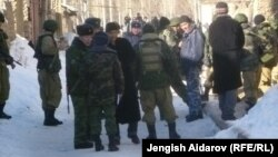 Residents and police gather in Uzbekistan's Sokh exclave on January 6.