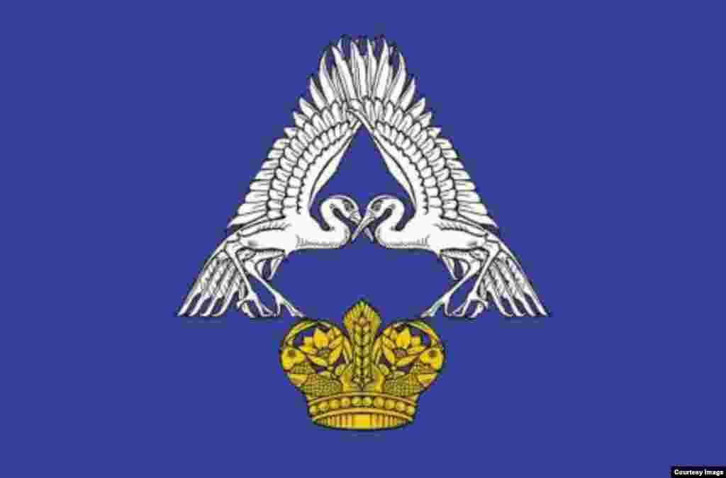 """Probably the fanciest one of the bunch. The A is for the river Akhtuba, after which the district – called Sredneakhtubinsky, in the Volgograd region – is named. The cranes are for """"cheerfulness and love,"""" and the crown symbolizes the region's wealth."""