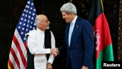 File photo of US Secretary of State John Kerry and Afghan president Ashraf Ghani.