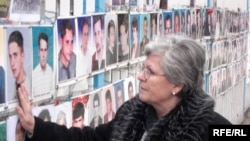 "A photo of Nesrete Kumnova's son, Albion, is among the more than 300 such photos of the ""not found"" hanging on a fence outside the Kosovar parliament."