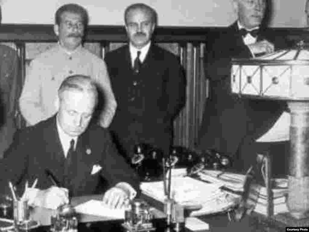 "German Foreign Minister Joachim von Ribbentrop inks the agreement. - After the signing ceremony, Stalin proposed a toast: ""I know how much the German people love their Fuehrer,"" he said. ""I should therefore like to drink to his health."""