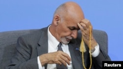 Afghan President Ghani, seen here at an international anticorruption summit in London in May 2016, has recently overseen hundreds of dismissals of government employees for graft.