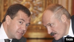 Did Russia's Dmitry Medvedev (left) get enough from Belarus's Alyaksandr Lukashenka...