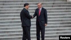 Президенты Китая и Турции Си Цзиньпин и Реджеп Эрдоган в Пекине, 2 июля 2019 г