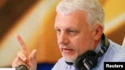 Pavel Sheremet talks on the air at a radio station in Kyiv in October 2015.