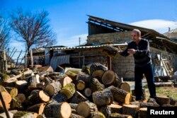 An ethnic Tartar piles wood in his garden in Belogorsk, near the Crimean capital, Simferopol.