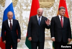 Хозяин и гости: белорусский президент, а также его украинский и российский коллеги