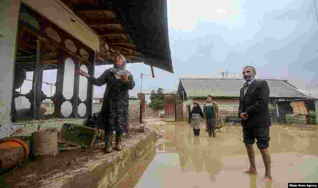 Residents of northern Iran show their flood-damaged home.