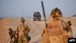 British soldiers search for explosives in Helmand Province in southern Afghanistan.