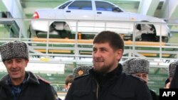 Ramzan Kadyrov (center) attends the opening ceremony for the Lada Priora assembly line in Chechnya in January 2012.