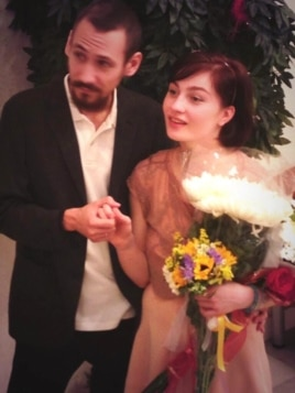Aleksandra Dukhanina and her husband, Artyom Naumov, during their wedding at a marriage-registry office in Moscow.