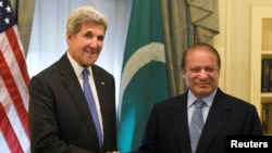 U.S. Secretary of State John Kerry shakes hands with Pakistani Prime Minister Nawaz Sharif during a bilateral meeting at the Waldorf Astoria in Manhattan, New York, on September 19.
